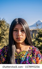 Cajola, Quetzaltenango, Guatemala, December 1, 2019, face of Mayan indigenous woman with long straight hair with her typical colorful blouse, with figures of flowers and animals, fighting for women's