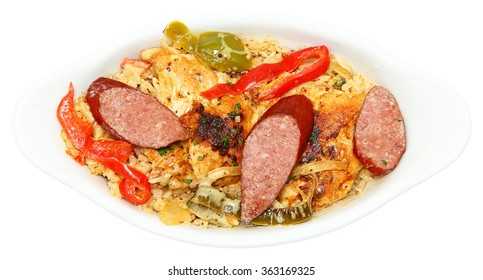 Cajun Jambalaya Voodoo Chicken and Sausage in white bowl isolated on white.