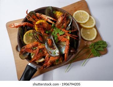 Cajun Seafood in a pan, choppingboard