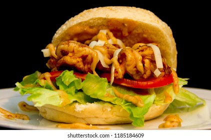 Cajun Shrimp Sandwich with Mozzarella Cheese on Lettuce and Tomato