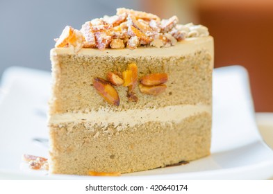 cake with almonds and nut ,Piece of cake with nuts