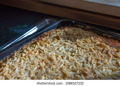 Cake with almonds on a baking tray