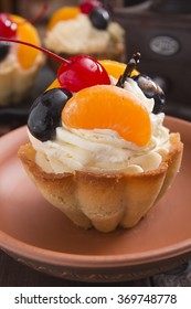 Cake - a basket of dough with cream and cherry.