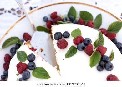 cake with berries on a white tablecloth close up