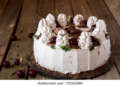 """Cake """"Black Forest"""" or Schwarzwald made of chocolate biscuit with tender cream and cherry, German cake, dessert from Germany and Austria"""