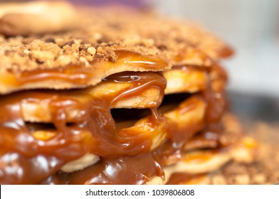 Cake with caramel and nuts, close-up