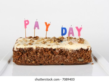 A cake celebrating 'pay day' with the candles blown out