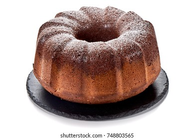 Cake of chocolate and vanilla on stone plate, isolated on white background.