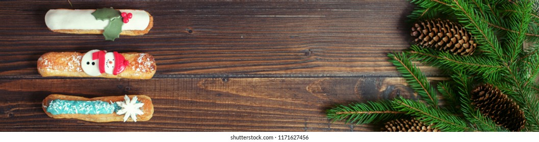 Cake and Christmas tree on a wooden background. Banner for the site. The concept of Christmas and New Year