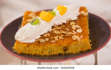 Cake with cream and fruit