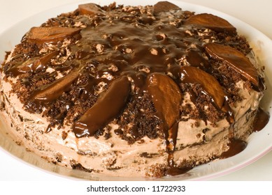 cake with cream and pear in chocolate
