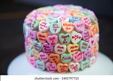 Cake decorated with heart shaped candy and Coldplay song titles!