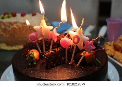 Cake decorated with stars and candles. 10th anniversary.