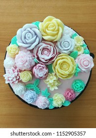 Cake decorating is one of the art, this one is made from Coconut milk and jelly. Different flowers such as lotus and roses big and small sizes and style in sweet colors giving feeling of love and care