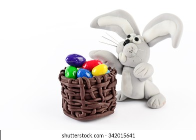 Cake decoration, Colorful easter eggs and rabbit isolated on white for decoration