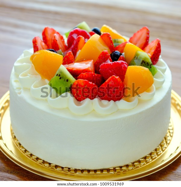 Brilliant Cake Exotic Fruits Over Wooden Background Stock Photo Edit Now Funny Birthday Cards Online Overcheapnameinfo