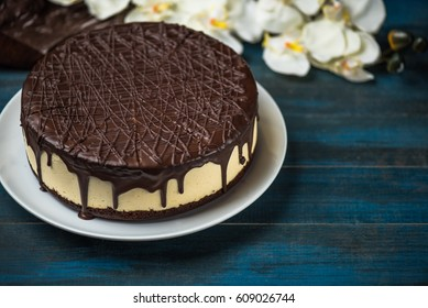 Cake and flowers on a wooden table. Dessert table close-up. Healthy food. Breakfast.