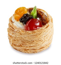 cake with fruits in a basket of dough kataifi isolated on white background