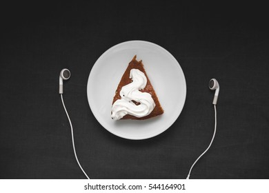 Cake and headphones on a black background