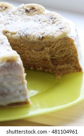 Cake with honey,coconut  and banana covered by white cream