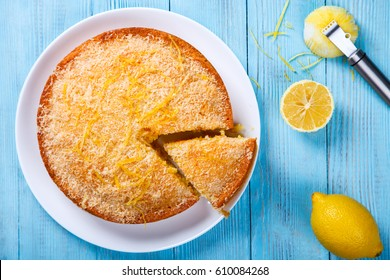 Cake with Lemon and Coconut.Homemade Cakes on a Blue Background.Copy space for Text. selective focus.