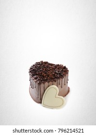 cake or love shaped chocolate cake on a background
