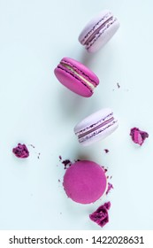 Cake macaroons or macaroons on white background, top view.Different types of macaroons in motion falling on light  Bright colors, vintage card.Card with sweets.Sweet and colorful french macaroons fall