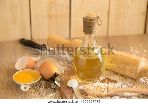 Cake making equipment. wooden rolling pin and Various wooden on brown table.
