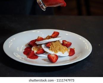 Cake meringue with fresh strawberries