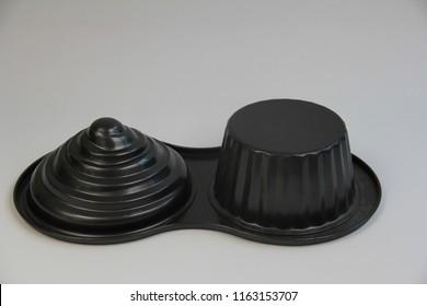 Cake moulding Polytetrafluoroethylene (PTFE).