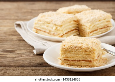 Cake Napoleon of puff pastry with sour cream. Close up.