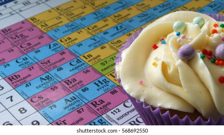 Cake on background of periodic table