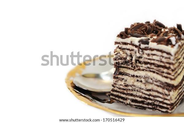Cake on a golden saucer.