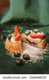 cake on a green fon with some fruits