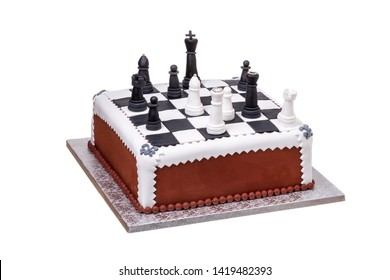 Cake on holiday chess pieces on the board from black and white cream.