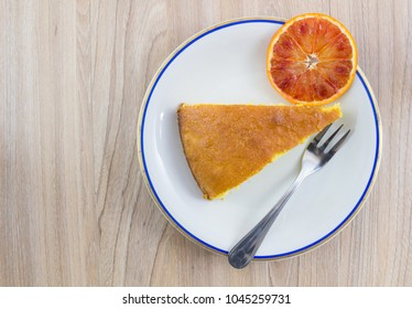 Cake, orange cake with orange slide in white plate on wood table background, Top view with copy space.