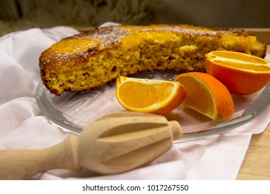 A cake with oranges on a white napkin