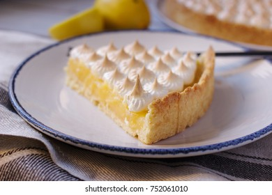 Cake pastry, meringue and cream of lemons on the table