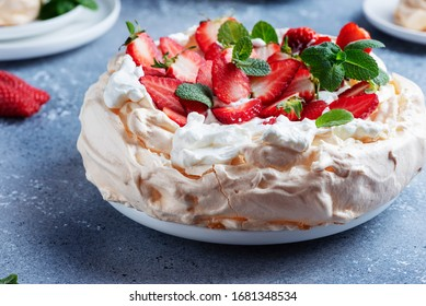 Cake Pavlova with meringue, strawberry and cream, selective focus image