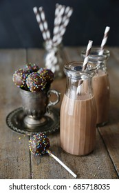Cake pops and chocolate milk on table