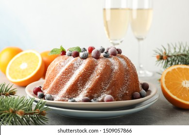 Cake with powder sugar and berries on grey table. Happy new year concept