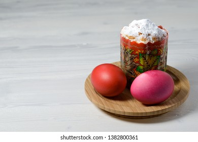 cake in powdered sugar and boiled painted eggs