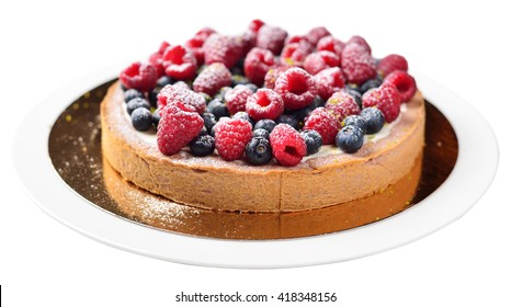 cake with raspberries and blueberries, isolated