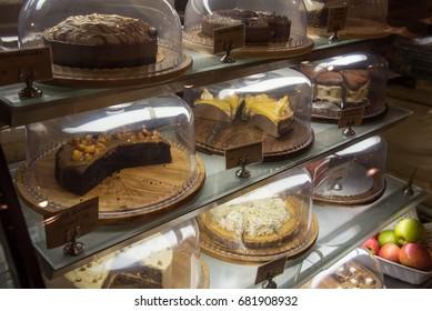 Cake in the refrigerator shown in shelf for sale with price tag and name