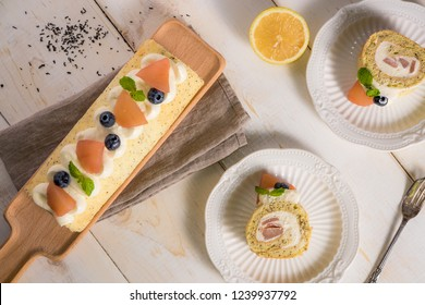 Cake roll with fresh fruits decorations