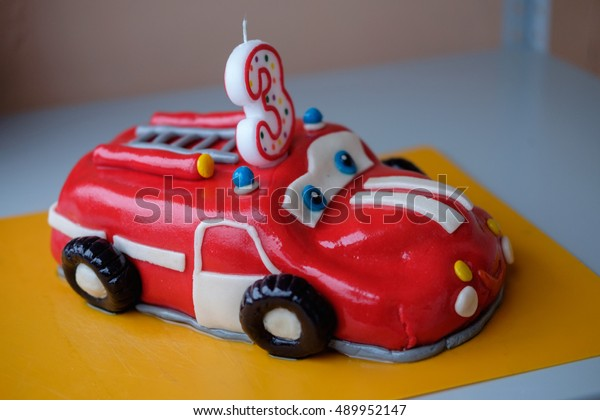 A Cake In The Shape Of Fire Truck For Boy Three Years To