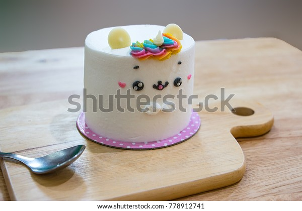 Cake Shape Unicorn On Wooden Table Stock Photo (Edit Now