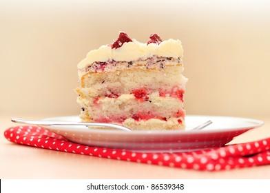 cake with strawberries, cream, coconut