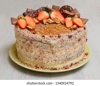 Cake with strawberries on grey