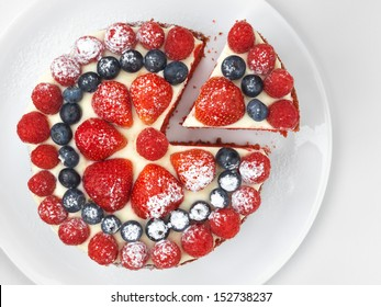 Cake with strawberries, raspberries and blueberries, high angle